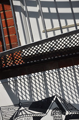 DSC_0654 [ps] - Mart (Anyhoo) Tags: uk shadow england urban white abstract black metal illustration writing floor graphic mesh drawing steel balcony text surrey metalwork barrier lettering grille railing drawn godalming stationroad anyhoo auctionmart photobyanyhoo