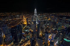 the beauty of the city at kuala lumpur (gilbertchuachian_siong) Tags: travel light building tower tourism photography asia cityscape arch photographer sony petronas twin malaysia destination nightview kualalumpur interest klcc aasia citylight samyang a6000