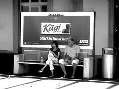 Glcklich / happy (krinkel) Tags: blackandwhite bw happy waiting bahnhof railwaystation publicity werbung schwarzweiss solothurn warten glcklich