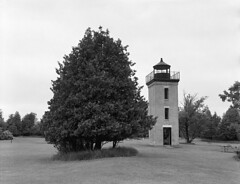 Peninsula Point Lighthouse (Bronica John) Tags: county blackandwhite bw lighthouse white lake black yellow mi speed self plane de point bay lighthouses graphic kodak michigan delta lakemichigan filter shutter epson peninsula developed township graflex stonington noc 135mm yellowfilter speedgraphic xtol selfdeveloped focal 2016 pacemaker deltacounty v500 ilfordhp5400 photostock peninsulapoint optar lakemichiganlighthouses focalplaneshutter 135mmoptar film:iso=400 lakemichiganlighthouse kodakxtol pacemakerspeedgraphic film:brand=ilford peninsulapointlighthouse stoningtonmi film:name=ilfordhp5400 developer:brand=kodak developer:name=kodakxtol stoningtonmichigan photostock2016 baydenoctownship filmdev:recipe=10837