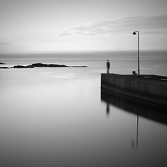 Watching the Time Go By (panfot_O (Bernd Walz)) Tags: longexposure sea blackandwhite bw seascape reflection water monochrome square person evening coast pier time dusk fineart peaceful tranquility atmosphere calm balticsea minimal shore silence minimalism contemplation bornholm waterscape