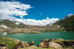 Lulusar lake (imtiazchaudhry) Tags: sky people lake mountains green clouds stones tourists glaciers snowclad