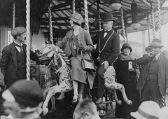 Sheriff on his horse at the Hoppings (Tyne & Wear Archives & Museums) Tags: 1920s boy horse woman man blur industry stockings hat shirt standing scarf 1932 outdoors shoe lights glasses necklace interesting shine hand lordmayor dress unitedkingdom debris grain decoration hats tie bowtie twist carousel pole suit nostril cap archives wife leisure ribbon unusual sheriff 1912 seated funfair tyneside attentive waistcoat distracted newcastleupontyne fascinating 1877 digitalimage blyth citycouncil alderman townmoor amusementride socialhistory hoppings northeastengland blackandwhitephotograph gallopinghorses northeastofengland royalvictoriainfirmary 192425 servingthecity 193637 fundraisingday johngrantham temperancefestival 26june1925 sheriffofnewcastle townmoortemperancefestivalhoppings mrsgrantham