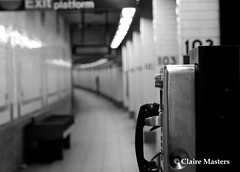The Waiting (Claire Masters) Tags: new york city blackandwhite black lines america underground waiting phone metro seat sony bricks numbers a350