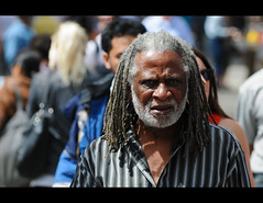 Rasta Mon (Poocher7) Tags: old portrait music toronto dreadlocks walking beard intense african candid stripes crowd streetphotography oldman sidewalk stare mean reggae dreads jamaican rasta rastafarian greyhair whitebeard angrylook