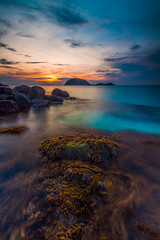 Beautiful Redang Island: Part I (Hafidz Abdul Kadir) Tags: travel light red sea vacation sky orange cloud sun sunlight color tourism beach water sunshine weather yellow stone night sunrise canon season relax landscape photography mirror scenery colorful paradise surf day waves peace open view natural outdoor background traditional horizon dream wave sunny nobody clear shore malaysia slowshutter tropical getty 5d rest splash tranquil pantai terengganu scapes gettyimages squeaky twop flickraward 1635f28 5dmark2