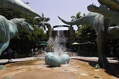 A water fountain with dinosaur eggs and dinsosaurs in Universal Studios Singapore (Ashish A) Tags: trees plants plant tree green tourism water fountain asian singapore asia tourist tourists greenery universalstudios waterfountain sentosa dinosaurs touristattraction attraction dinosaureggs universalstudiospark entrancetojurassicparkride entrancetoride jurassicparktheme lostworldzone waterfountainwithdinosaureggs