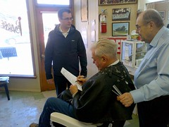 Monte gathers signatures on a petition to stop the trades tax at Webster's Barbershop in Glencoe.