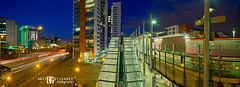 London Docklands Panorama 3 (david gutierrez [ www.davidgutierrez.co.uk ]) Tags: city uk travel blue light red sky urban panorama london art tourism colors skyline architecture train twilight cityscape dusk transport railway londres docklands lighttrails bluehour dlr  londyn    pentaxk5