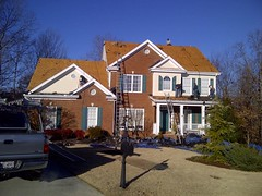 Weathered wood shingle during roofing project