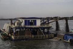 Dredging the Mekong (Keith Kelly) Tags: city cruise sunset water river fun boat sand asia cambodia seasia southeastasia mud capital working phnompenh kh aroundtown barge mekong dredge dredging silt tonlesap kampuchea dredgingderrick