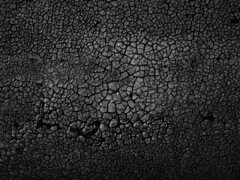 Black cracked abstract texture background. (Prabu Dhanapal) Tags: old abstract black detail macro texture broken closeup dark background surface crack shelling worn material split shady shatter cracked crackle crackles obsolete fissure cranny frayed chapped shaded shadowy shabby craquelure rupture threadbare craquelures