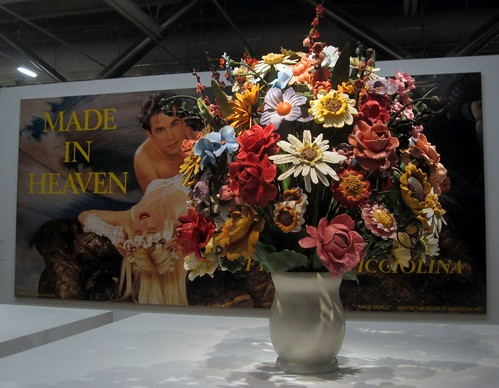 Made In Heaven Poster Partly Hidden By A Large Vase Of Flowers