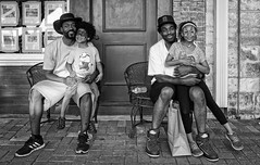 Doubles (Anne Worner) Tags: street boy blackandwhite bw men girl monochrome hat smiling children outside mono hugging holding shoes sitting chairs streetphotography georgetown sneakers friendly facepaint ricohgr fathers baseballcap onlap anneworner
