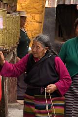 Tibetan Elder Turning Prayer Wheels (Journey CPL) Tags: old wheel lady costume faith prayer religion culture tibet age elder tibetan ethnic lhasa wrinkle