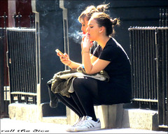 `1673 (roll the dice) Tags: london westminster soho w1 westend couple girls sexy pretty sad mad surreal smoke fag cigarettes chest lungs smoking hot sunny weather people natural lunch break mobile phone talk uk art classic urban unaware england strangers candid londonist streetphotography legs shadow adidas light fashion canon tourism