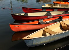 On the Water (Karen_Chappell) Tags: travel blue red lake canada reflection water yellow boats boat ottawa canoe dowslake
