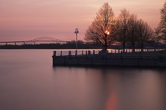 two minute sunset, sault ste. marie (twurdemann) Tags: longexposure trees sky seascape ontario canada reflection water evening spring dock waterfront shoreline boardwalk saultstemarie northernontario internationalbridge 2minutes stmarysriver neutraldensityfilter 120seconds hubtrail hoyandx64 xf1855mm fujixt1 johnrowswell bondermarina