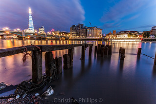 London's and Europe's tallest building as seen from the shore of the river Thames at night