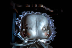 There's always two sides to every story... (Maura Lindsey) Tags: old blue light sleeping red baby white dusty halloween face dark lost doll child sad faces natural sleep lace antique crying creepy angry heads crib framing cry asymmetry porcelain divided