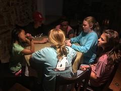 Serious gamers in the spotlight (Pejasar) Tags: game card night hotel antigua guatemala girls boy light dark spotlight
