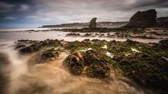 Rocks in the Mist (Augmented Reality Images (Getty Contributor)) Tags: beach canon cliffs coastline cullen landscape leefilters longexposure rocks sand scotland sea seascape seaweed tide village water waves