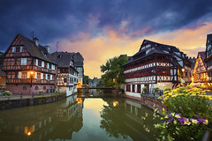 Strasbourg. (Rudi1976) Tags: street city travel sunset sky urban house france reflection building tourism water skyline architecture river outdoors canal twilight europe cityscape exterior waterfront outdoor dusk landmark calm medieval illuminated strasbourg petitefrance famousplace traveldestination
