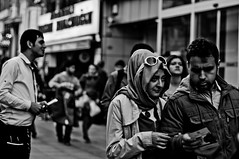 (Taygun AHISKALI) Tags: life street city portrait urban blackandwhite white black public sunglasses contrast turkey walking photography 50mm photo blackwhite aperture waiting noir f14 candid sony uv streetphotography streetscene scene istanbul stranger filter shutter hd af leaflet brochure blanc pamphlet hoya lavie larue photoderue a580 laphotographiederue taygunahiskali