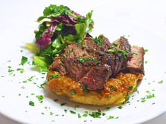 fried polenta with onion pepper jam, beef, and spring greens (andy pucko) Tags: pepper salad beef salt butter garlic onion oliveoil parsley whitewine tomatosauce polenta worcestershiresauce vinaigrette redchili sweetredpepper onionpepperjam