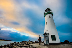 Looking up at the Walton Lighthouse (Brian Menges) Tags: ocean door blue summer santacruz lighthouse water yellow clouds sunrise landscape person dawn harbor waves overcast lightouse waltonlighthouse naturalhdr