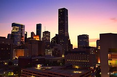 Houston at dawn (elnina999) Tags: park plaza new city travel blue trees windows sky urban panorama cloud reflection building cars window glass lamp skyline architecture modern skyscraper fence buildings circle corporate drive office high highway downtown day commerce cityscape texas exterior view traffic cloudy district famous platform houston sunny landmark center panoramic business round infrastructure metropolis tall shape finance nikond5100