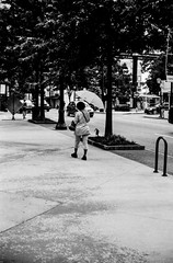 Ready For Rain (Mark Sinderson) Tags: street atlanta people usa house film umbrella 35mm ga georgia us fuji unitedstates midtown developer northamerica lenses developing yashicaelectro35gsn 35mmrangefinder kodakhc110 neopanacros100 camerabodies yashinondx45mmf17