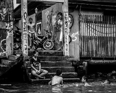 On the canal - Bangkok (Nathan A Rodgers) Tags: travel blackandwhite bw children thailand asia southeastasia child bangkok streetphotography countries streetscenes 2012 travelphotography