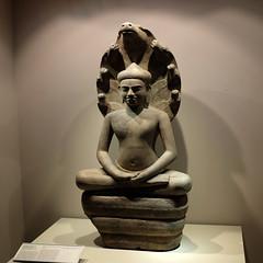 Sandstone figure of Buddha protected by Naga Muchalinda (Cambodia)
