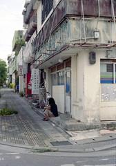 銀天街 しゃがむひと Okinawa-si, Okinawa (ymtrx79g ( Activity stop)) Tags: street color slr film japan analog nikon kodak 35mmfilm okinawa 135 沖縄 kodakgold100 街 写真 銀塩 フィルム nikonnewfm2 沖縄市 nikonainikkor50mmf14 stopandwait 停止待機 201310blog okinawasi