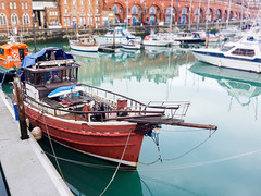 Dockside (bardi09) Tags: new wood uk travel red sea england water docks reflections boats boat seaside fishing unitedkingdom calm quay tokina mooring woodenboat ramsgate bardi