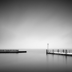 The Wintery Harbour (panfot_O (Bernd Walz)) Tags: longexposure winter sea blackandwhite bw seascape water monochrome harbour fineart balticsea minimal silence minimalistic contemplation waterscape minimalisticlandscape