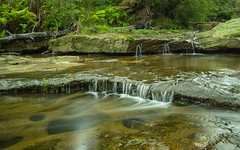 Oxford Falls #2 (JamesCookPhoto) Tags: blur fern creek waterfall moss rocks stream australia olympus cascades nsw slowshutter zuiko ep3 oxfordfalls 2014 ndfilter slowwater