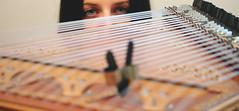 Eyes on the fingerpicks (Geo.M) Tags: bridge blue music girl beautiful lady canon eos eyes traditional rita indoors rings musical instrument shooting 1855mm efs picks georgios kanun γέφυρα 700d παραδοσιακό γεώργιοσ miliokas μηλιώκασ όργανο κανονάκι πένεσ μουσικό δακτυλήθρεσ