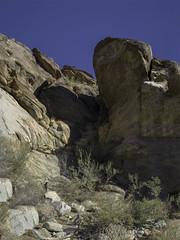 Rock Panorama (AR_the old guy) Tags: california blue sky panorama rocks raw andreas canyon palm springs toned shrubs pb10413543