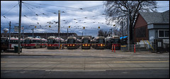 The Red Rockets (Lens Bubbles) Tags: 35mm ttc olympus f2 om streetcar redrocket queenstreeteast olympusom35mmf2