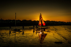 End of the Day (RonnieLMills) Tags: sun silhouette boats sailing harbour setting toppers donaghadee