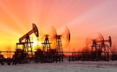oil pumps (otoxunghe) Tags: blue sunset sky snow industry silhouette energy industrial russia machine gas mining pump equipment siberia rig oil environment exploration fuel oilfield drilling petroleum pumpjack blurredmotion russianfederation wellhead