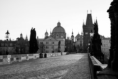 Sunrise on Charles Bridge (romanboed) Tags: leica old city morning travel bridge light bw sun white black tourism monochrome architecture sunrise town europe cityscape czech prague spires gothic prag charles praha praga m cobblestones most lanterns stare 50 bohemia summilux blackand praag 240 karluv czechia mesto cesko