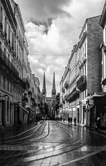 tram tracks lead to Bordeaux cathedral monochrome (PDKImages) Tags: old windows france church monochrome beauty abbey architecture ginger curves bordeaux shutters balconies stemillion brantome