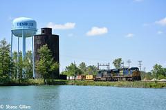 Csx Stopping at the lake in Deshler. (Machme92) Tags: railroad ohio sky lake water weather clouds pond nikon rail rails ge railroads csx conrail railroading railfanning csxt gevo railfans nikond7200