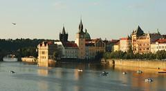The Moldau river in Prague (M a u r i c e) Tags: sunset sunlight building bird tower water river evening boat prague dusk czechrepublic cz ef50mmf18ii moldau