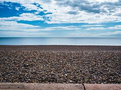 Pebble beach (dash.null) Tags: blue england lumix unitedkingdom stones peaceful panasonic pebble gb seaton g7 lumixg7