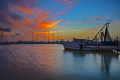_40A4069 (ChefeGrande) Tags: reflection silhouette clouds marina sunrise landscape texas outdoor coastal serene seashore shrimpboats gulfcoast
