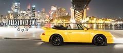 Carrera (celsydney) Tags: logo porsche harbourbridge sydneyharbour carrera 993 sydneyskyline newlogo carrera4 celsydney yellowporsche